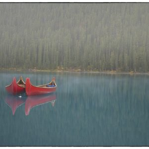 Pair of Canoes on a misty morning