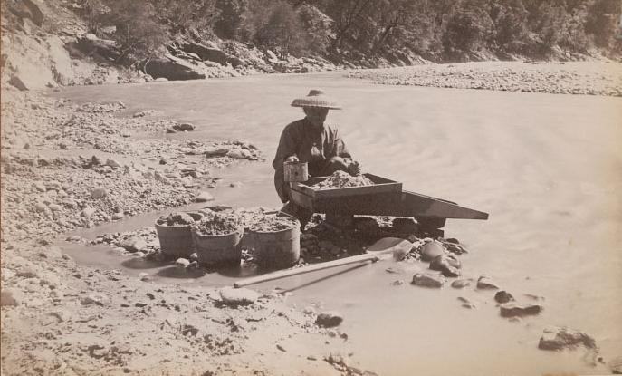 Chinese-man-mining-along-a-river